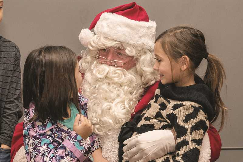 Don Comstock of Men's Auxiliary Plays Santa for CPAH